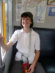 A happy student on the train